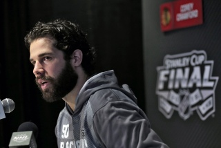 Chicago Blackhawks goalie Corey Crawford answers a question during media day for the NHL hockey's Stanley Cup Finals Tuesday, June 2, 2015, in Tampa, Fla. The Blackhawks take on the Tampa Bay Lightning in Game 1 on Wednesday. (AP Photo/Chris O'Meara)