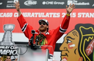 Chicago Blackhawks defenseman Duncan Keith celebrates as he speaks during a rally celebrating the NHL hockey club's Stanley Cup championship, Thursday, June 18, 2015, at Soldier Field in Chicago. (AP Photo/Nam Y. Huh)