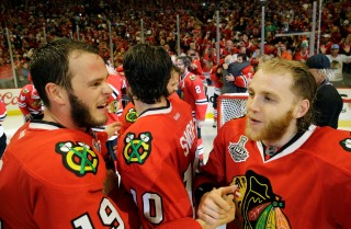 Chicago Blackhawks' Jonathan Toews, left, and Patrick Kane after defeating the Tampa Bay Lightning in Game 6 of the NHL hockey Stanley Cup Final series on Monday, June 15, 2015, in Chicago. The Blackhawks defeated the Lightning 2-0 to win the series 4-2. (AP Photo/Nam Y. Huh)