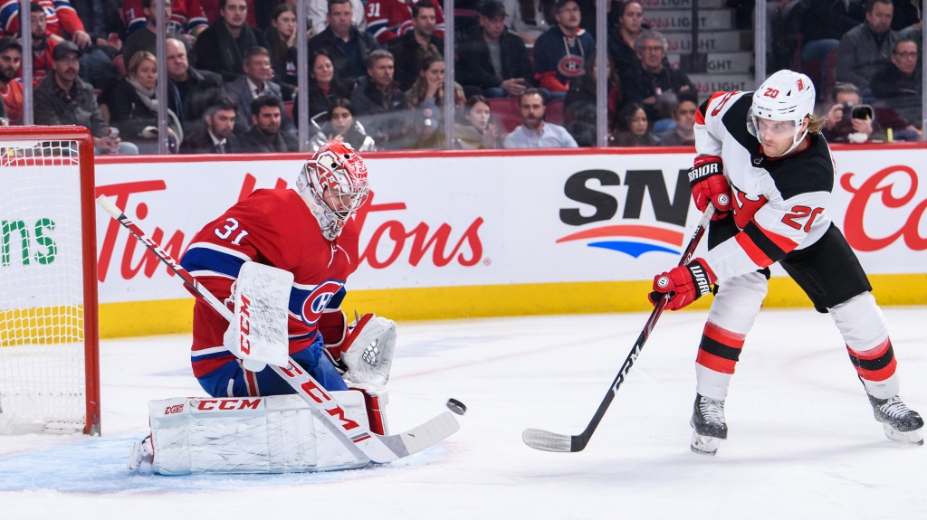 Blake Coleman of New Jersey Devils shoots on Montreal Canadiens goaltender Carey Price