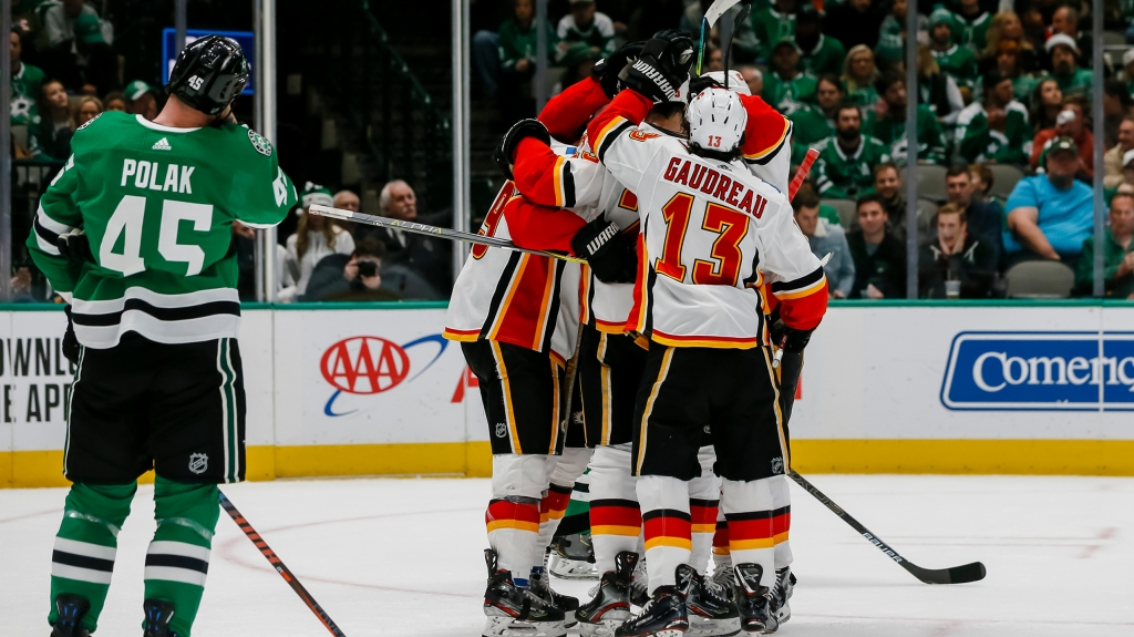 Calgary Flames left wing Matthew Tkachuk (19) celebrates with teammates after scoring a goal during the game between the Dallas Stars and the Calgary Flames