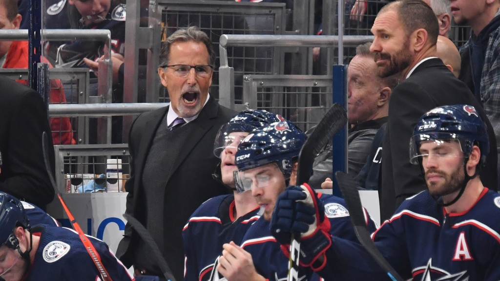 Head Coach John Tortorella of the Columbus Blue Jackets speaks to his players
