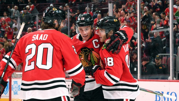 Patrick Kane #88 of the Chicago Blackhawks celebrates with Jonathan Toews