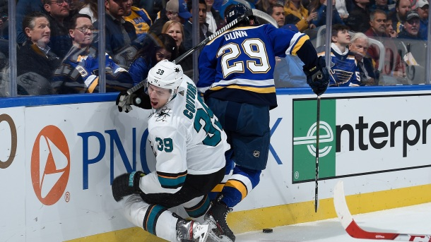 Vince Dunn #29 of the St. Louis Blues checks Logan Couture #39 of the San Jose Sharks