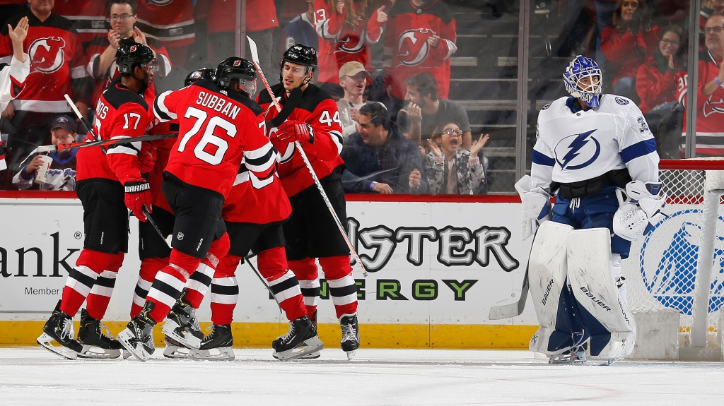 Andy Greene #6 of the New Jersey Devils is congratulated by his teammates after scoring a goal