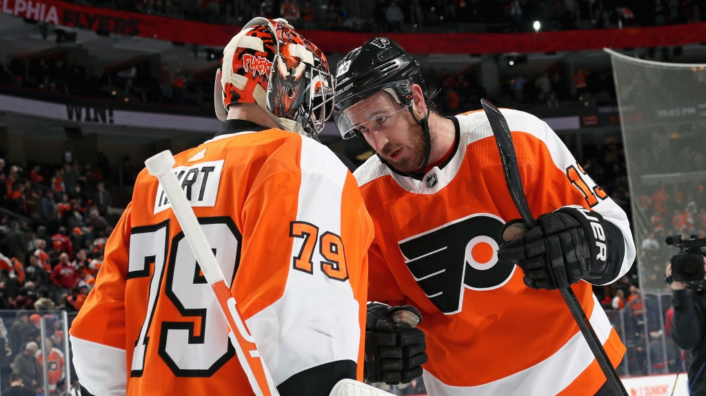 Carter Hart #79 and Kevin Hayes #13 of the Philadelphia Flyers