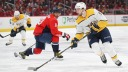 Filip Forsberg #9 of the Nashville Predators skates past Alex Ovechkin #8 of the Washington Capitals