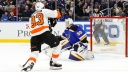 Philadelphia Flyers' Jakub Voracek, left, gets the puck past St. Louis Blues goaltender Jordan Binnington
