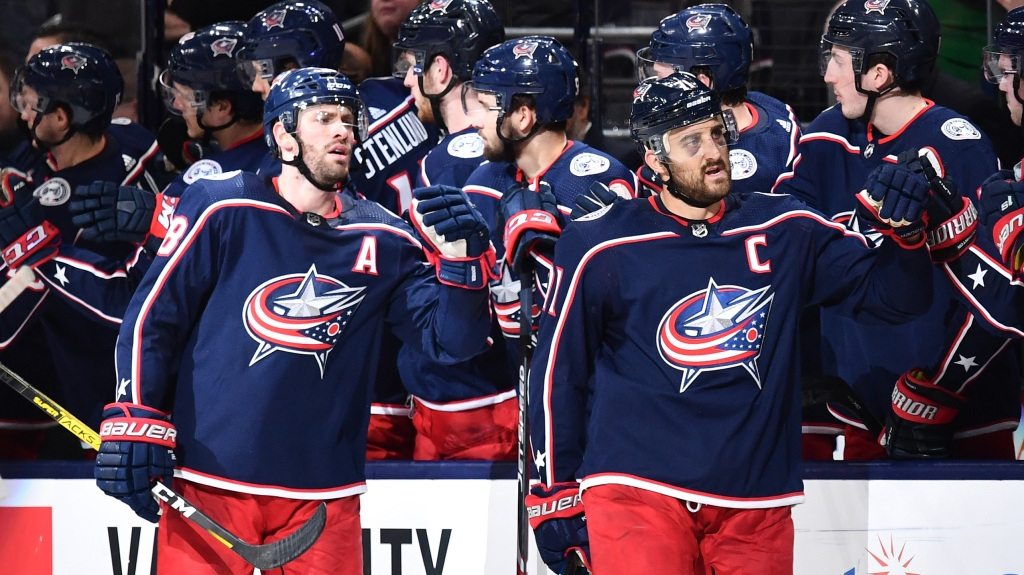Nick Foligno #71 of the Columbus Blue Jackets, right, and Boone Jenner #38 of the Columbus Blue Jackets celebrate Foligno's second period goal against the Ottawa Senators
