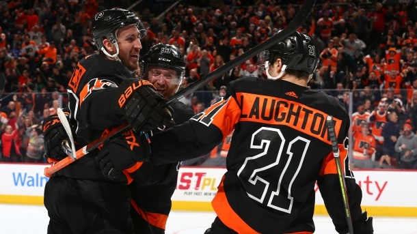 Kevin Hayes #13, Jakub Voracek #93, and Scott Laughton #21 of the Philadelphia Flyers celebrate