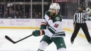 Jason Zucker #16 of the Minnesota Wild skates