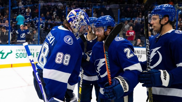 Goalie Andrei Vasilevskiy #88 and Brayden Point #21 of the Tampa Bay Lightning celebrate