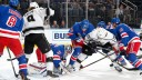 Igor Shesterkin #31 of the New York Rangers covers the puck against the Los Angeles Kings