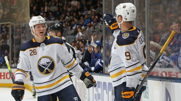 Jack Eichel #9 of the Buffalo Sabres celebrates his goal with teammate Rasmus Dahlin