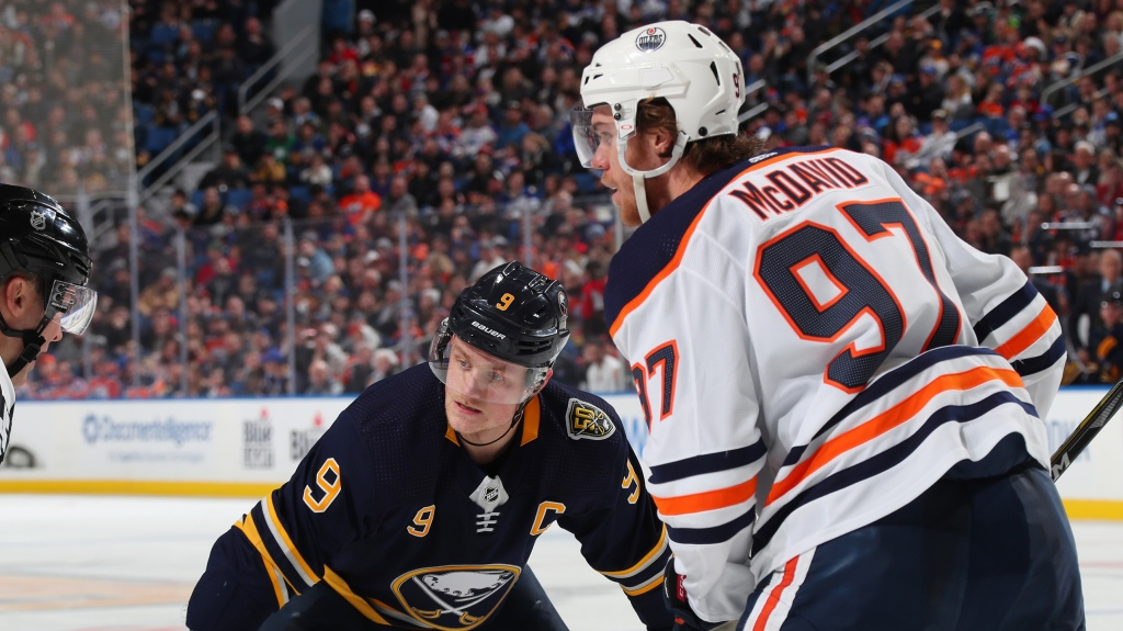 Jack Eichel #9 of the Buffalo Sabres prepares for a faceoff during an NHL game against Connor McDavid #97 of the Edmonton Oilers