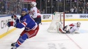 Mika Zibanejad #93 of the New York Rangers scores his fifth goal of the game in overtime