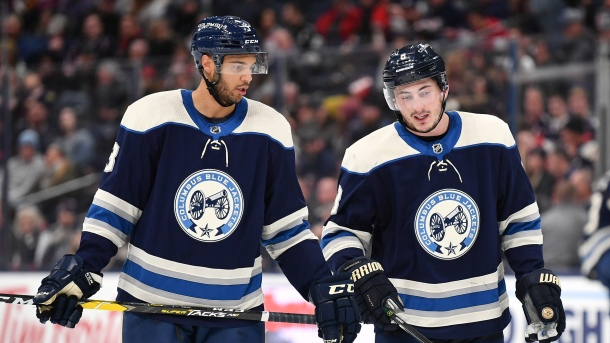 Seth Jones #3 and Zach Werenski #8 of the Columbus Blue Jackets talk