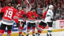 Patrick Kane #88 and Alex DeBrincat #12 of the Chicago Blackhawks celebrate
