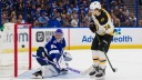Goalie Andrei Vasilevskiy #88 of the Tampa Bay Lightning gives up a goal against Jake DeBrusk #74 the Boston Bruins