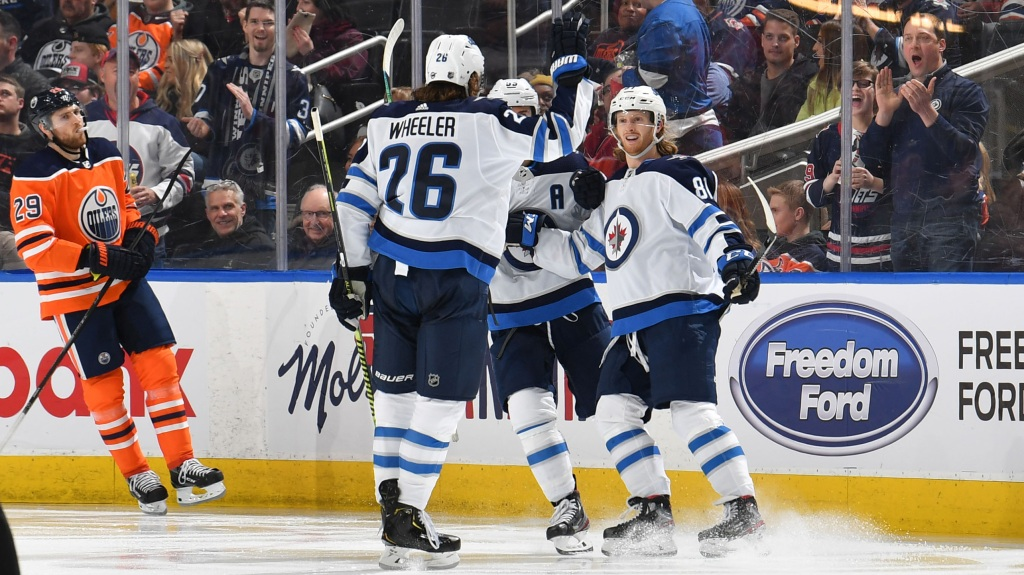 Kyle Connor #81, Blake Wheeler #26 and Mark Scheifele #55 of the Winnipeg Jets