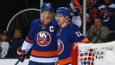Anders Lee #27 and Mathew Barzal #13 of the New York Islanders celebrate