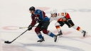 Colorado Avalanche center Nathan MacKinnon (29) pushes the puck forward on a break-away as Calgary Flames left wing Johnny Gaudreau